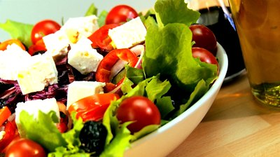 stock-footage-tempting-selection-of-fresh-crisp-salad-mozarella-cheese-oils-making-a-healthy-nutritious-meal
